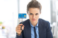 Serious business woman cutting credit card Royalty Free Stock Photo