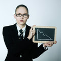 Serious business woman holding graphic board with deacreasing cu studio shot portrait of one showing blackboard curve Royalty Free Stock Image