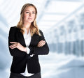 Serious business woman in the office modern building of great corporate successful career smart girl working in luxury Stock Image