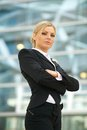 Serious business woman standing outdoors Royalty Free Stock Photo