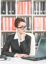 Serious business woman working with laptop Royalty Free Stock Image