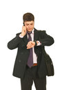 Serious businessman checking time Royalty Free Stock Photo