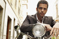 Serious businessman on motorbike portrait of young Stock Photography