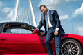 Serious businessman standing near car Royalty Free Stock Photo