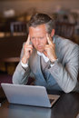 Serious businessman using his laptop at the cafe Royalty Free Stock Photo