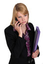 Serious businesswoman with files and a phone Stock Photography