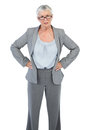 Serious businesswoman with her hands on hips white background Stock Photos
