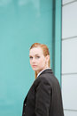 Serious businesswoman on her way to office young redhead the Royalty Free Stock Photo