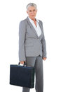 Serious businesswoman holding briefcase briefcaseon white background Stock Photography