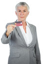 Serious businesswoman showing her credit card on white background Royalty Free Stock Image
