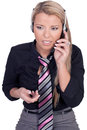Serious call center agent answering in a close up view Royalty Free Stock Photos