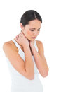Serious casual woman suffering from neck ache young over white background Stock Photos