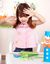 Serious child cutting paper. Stock Images