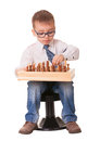 Serious child playing chess kid on white background Stock Photography