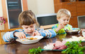 Serious children eating food