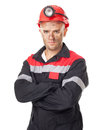 Serious coal miner portrait of with his arms crossed isolated on white background Stock Photos