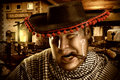 Serious cowboy mexican at night portrait of smoking cigar on a ranch Royalty Free Stock Photo