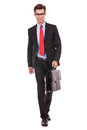 Serious fashion business man walking forward Stock Images