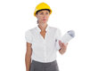 Serious female architect holding plans and hard hat on white background Royalty Free Stock Image