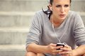 Serious female runner listening to music athlete mp during her break Royalty Free Stock Photos