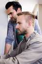 Serious gay couple working in office Stock Images