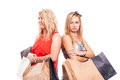 Serious girls shopping blond with bags isolated on white background Royalty Free Stock Photos