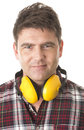 Serious handyman with earmuffs on white background Stock Image