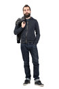 Serious hipster in hooded sweatshirt carrying jacket over the shoulder looking at camera full body length portrait isolated Stock Image