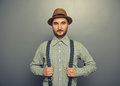 Serious hipster man portrait of over grey background Stock Image