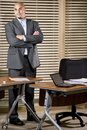 Serious Hispanic businessman standing in office Royalty Free Stock Photo