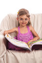 Serious little girl in glasses with big book Royalty Free Stock Image