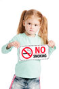 Serious little girl with no smoking sign unhappy holding a isolated on white background Stock Image