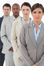Serious looking businessteam standing together Stock Images