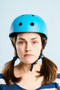 Serious looking young woman wearing cycling helmet Royalty Free Stock Images