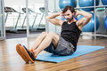 Serious man doing abdominal on the mat Royalty Free Stock Photo