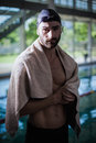 Serious man drying himself with a towel Royalty Free Stock Photo