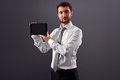 Serious man formal wear showing screen his tablet pc looking camera Stock Image