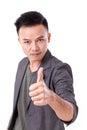 Serious man giving thumb up looking at you or camera Royalty Free Stock Photo