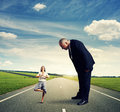 Serious man looking at small woman men calm women on the road Royalty Free Stock Photos