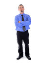 Serious man in shirt and tie looking at you arms crossed a business blue with his Stock Photo