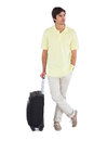 Serious man standing with his suitcase on q white background Royalty Free Stock Photo