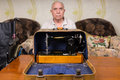 Serious Old Man Behind a Sewing Machine Case Royalty Free Stock Photo