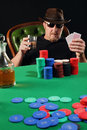 Serious poker player wearing sunglasses Stock Photos