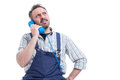 Serious repairman solving a work problem on telephone Royalty Free Stock Photo