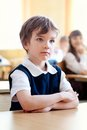 Serious schoolboy sitting at desk classroom Royalty Free Stock Photography