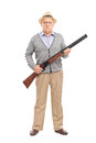 Serious senior gentleman holding a shotgun full length portrait of and looking at the camera isolated on white background Royalty Free Stock Photos