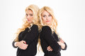 Serious sisters twins with arms folded Royalty Free Stock Photo