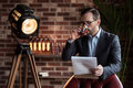 Serious stylish businessman taking a sip of whisky Royalty Free Stock Photo