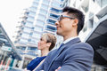 Serious about success and determined business team members standing next to each other in business district Royalty Free Stock Image