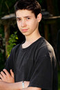 Serious teen boy a handsome sad or young with dark hair and black shirt shallow depth of field Stock Photo